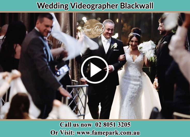 Bride and Groom walking through the crowd Blackwall NSW 2256