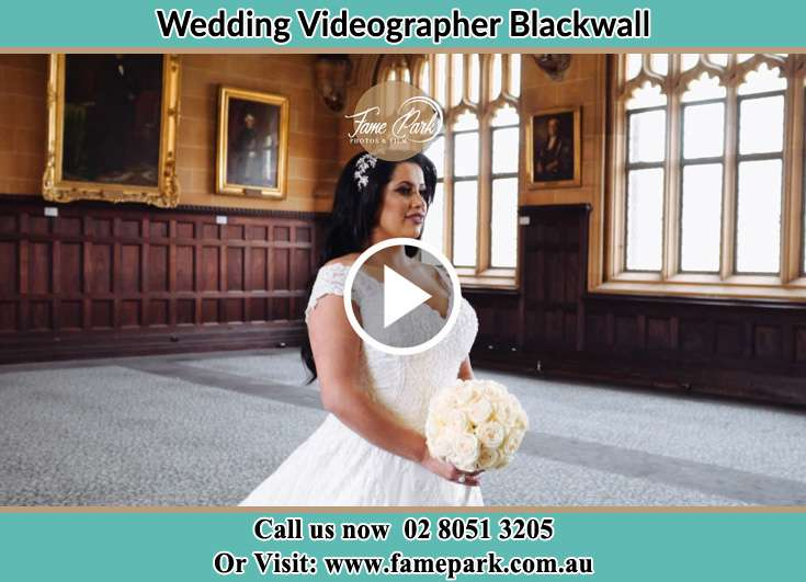 Bride holding a bouquet of flowers Blackwall NSW 2256