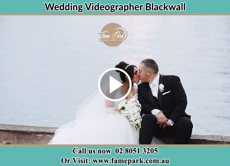 Bride and Groom kissed at the shore Blackwall NSW 2256
