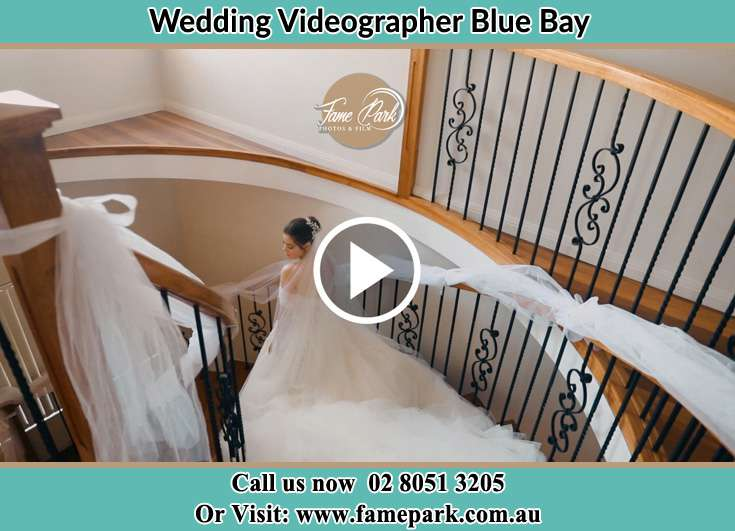 Bride walking down the staircase Blue Bay NSW 2261