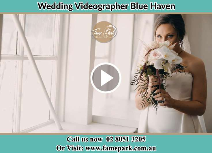 Bride holding bouquet of flowers Blue Haven NSW 2262