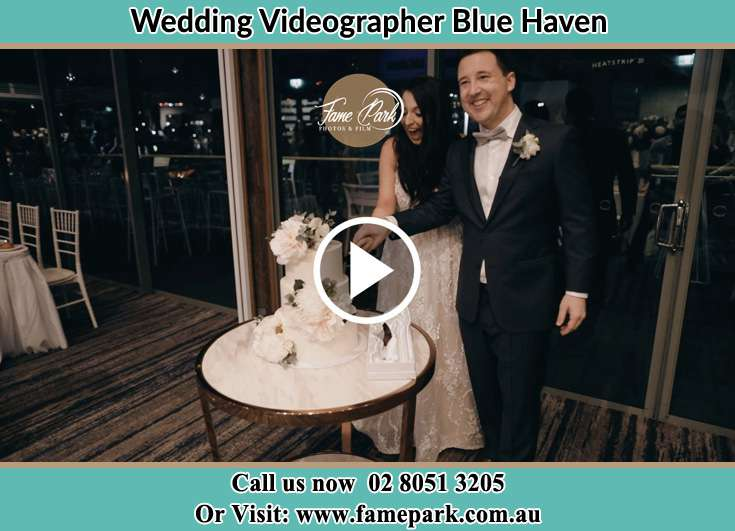 Bride and Groom cutting of cake Blue Haven NSW 2262