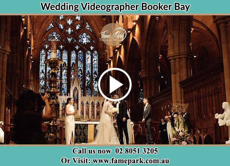 Bride and Groom kissed at the altar Booker Bay NSW 2257