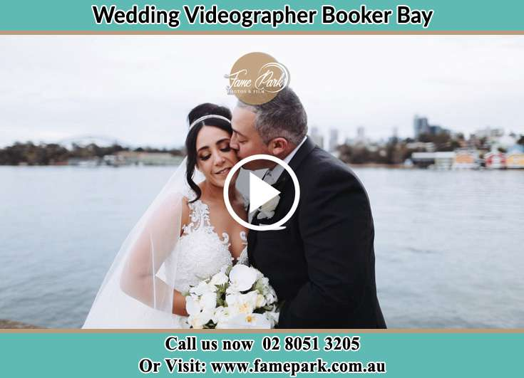Bride and Groom kissed near the shore Booker Bay NSW 2257