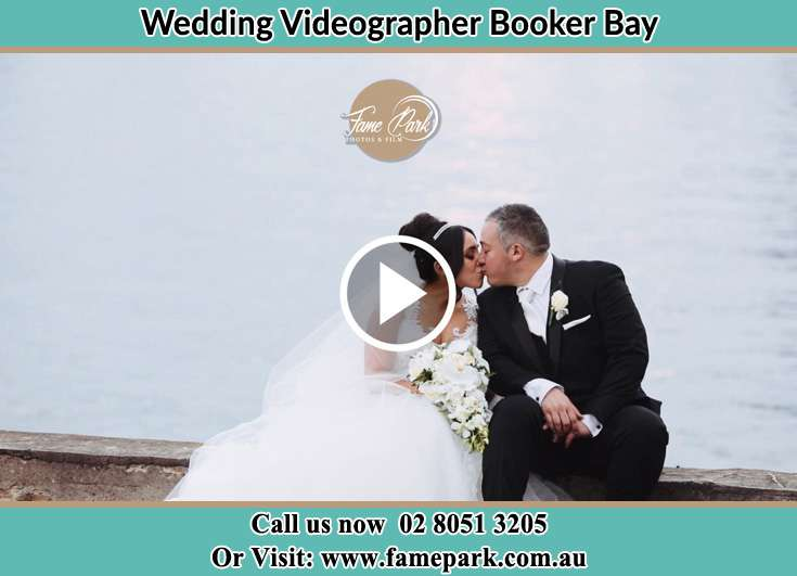 Bride and Groom kissed at the bay Booker Bay NSW 2257