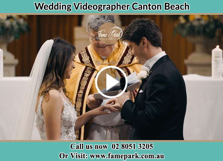 Bride and Groom looking at the ring in the altar Canton Beach NSW 2263