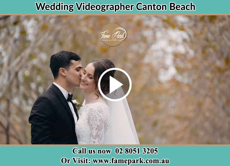 Bride and groom kissed at the park Canton Beach NSW 2263