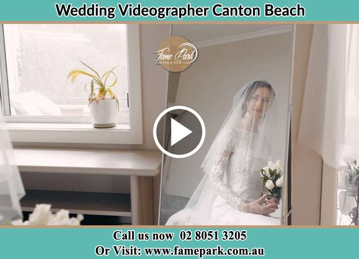Bride looking at the mirror Canton Beach NSW 2263