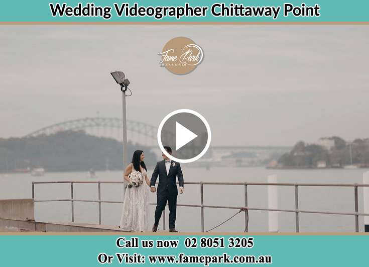 Bride and Groom walking at the shore Chittaway Point NSW 2061