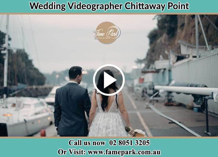 Bride and Groom walking at the harbor Chittaway Point NSW 2061