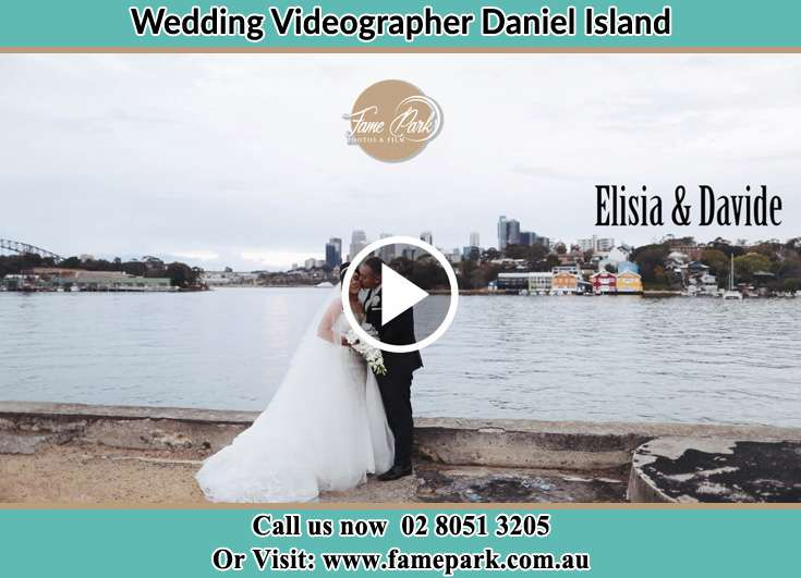 Bride and Groom kissed near the shore Daniel Island NSW 29492