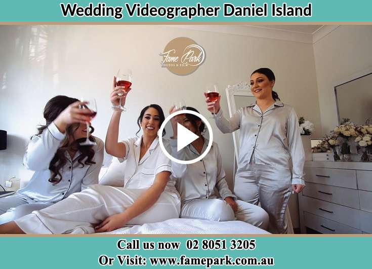 Bride and her secondary sponsors making toast during the pajama party Daniel Island NSW 29492
