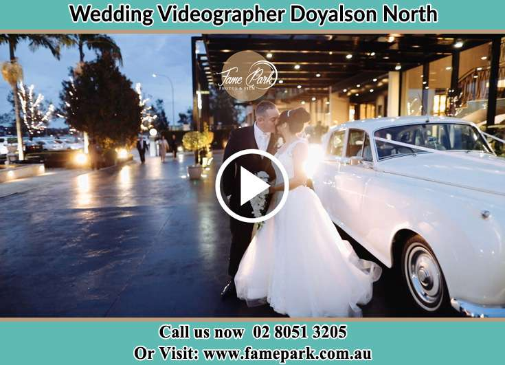 Bride and Groom kissed beside the bridal car Doyalson North NSW 2262