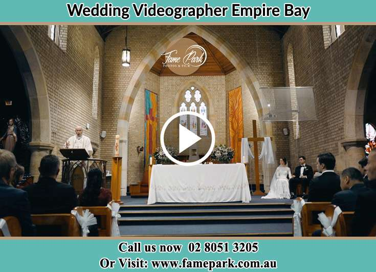 Bride and Groom at the church during the ceremony Empire Bay NSW 2257