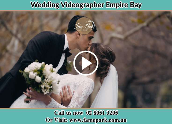 Bride and Groom kissed at the park Empire Bay NSW 2257