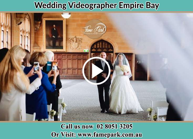 Bride and her father walk in the aisle Empire Bay NSW 2257