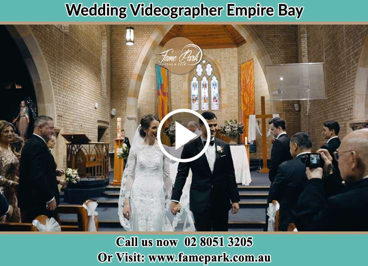 Bride and Groom watching their guest while walking at the aisle Empire Bay NSW 2257
