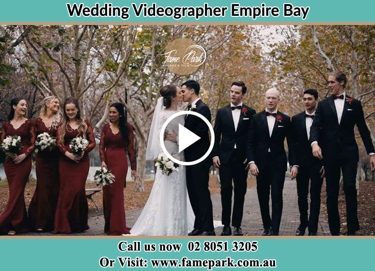 Bride and Groom kissed at the park with their secondary sponsors Empire Bay NSW 2257