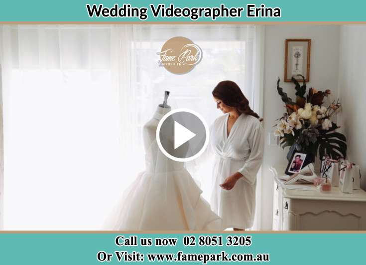 Bride looking at her wedding gown Erina NSW 2250
