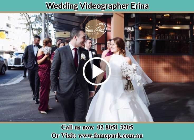 Bride and Groom looking at each other while walking in the street Erina NSW 2250