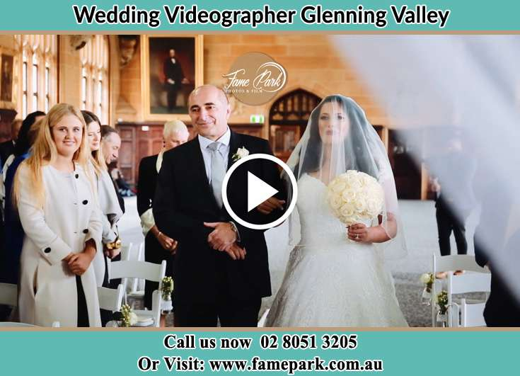 Bride and her father walking in the aisle Glenning Valley NSW 2261