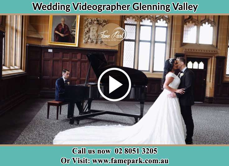 Bride and Groom kissed besides the piano Glenning Valley NSW 2261