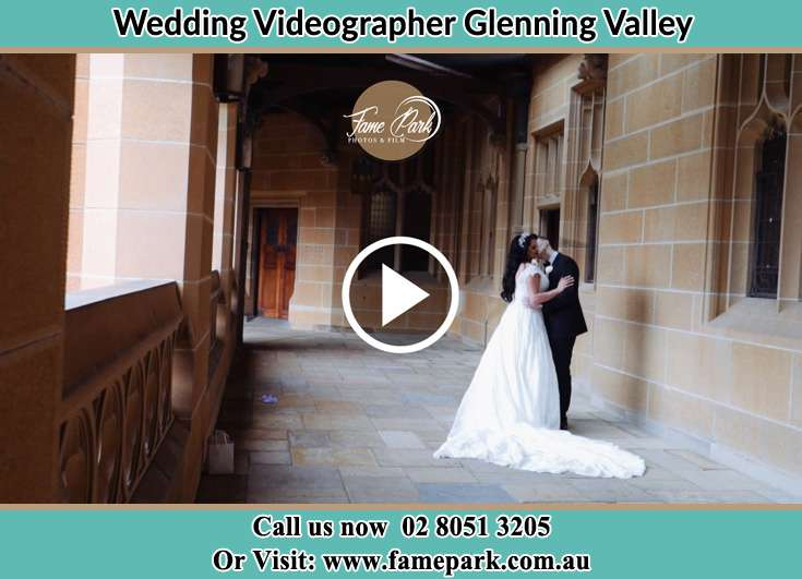 Bride and Groom kissed at the church hallway Glenning Valley NSW 2261