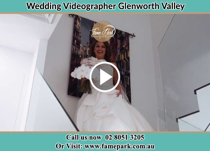 Bride getting down the staircase Glenning Valley NSW 2261