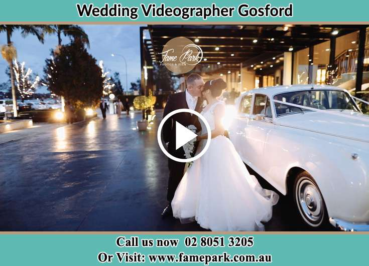 Bride and Groom kissed beside their bridal car Gosford NSW 2250