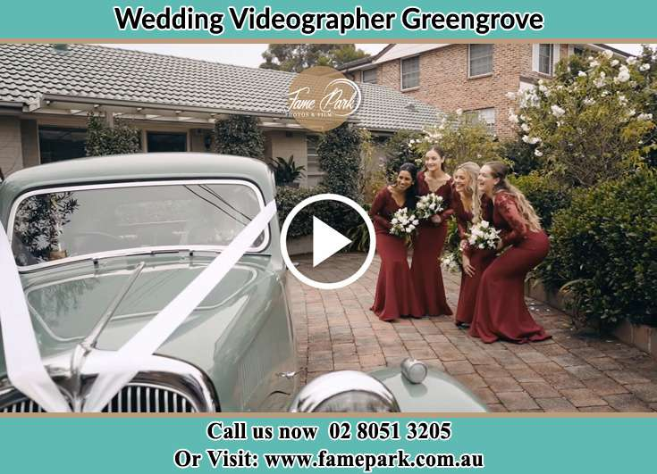 Bride's secondary sponsors looking at the bridal car Greengrove NSW 2250