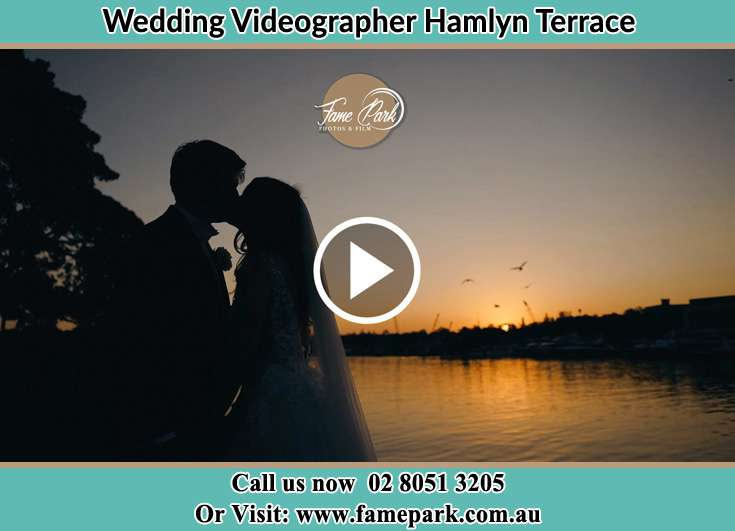 Bride and Groom kissed at the lake shore Hamlyn Terrace NSW 2259