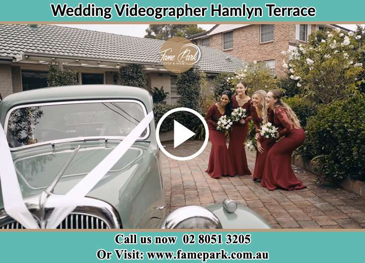 Bride's secondary sponsors looking at the bridal car Hamlyn Terrace NSW 2259