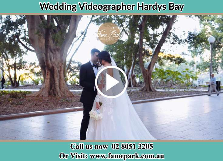 Bride and Groom looking at each other at the park Hardys Bay NSW 2257