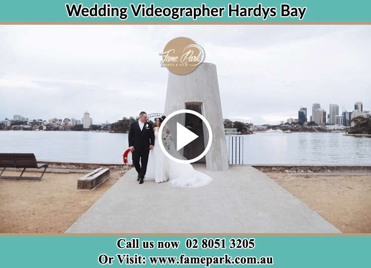 Bride and Groom walking at the shore Hardys Bay NSW 2257