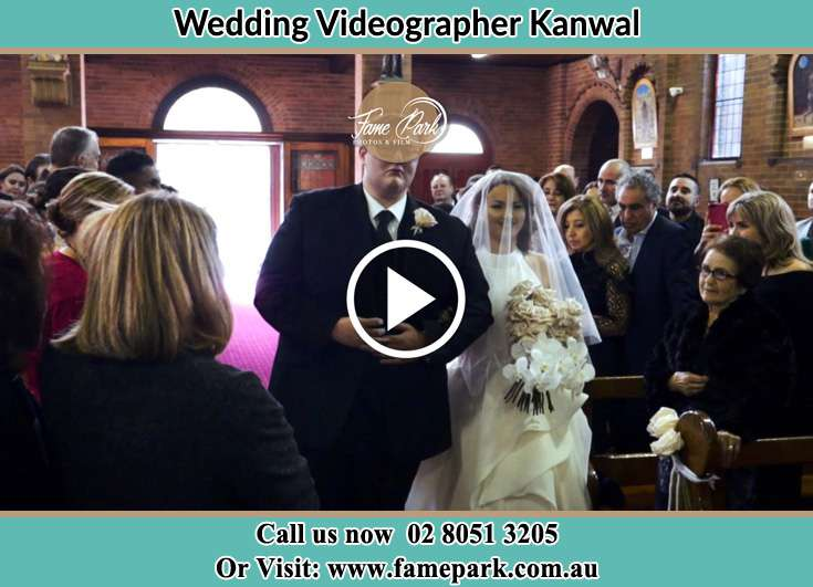 The Bride and her fatherr walk toward the altar Kanwal NSW 2259
