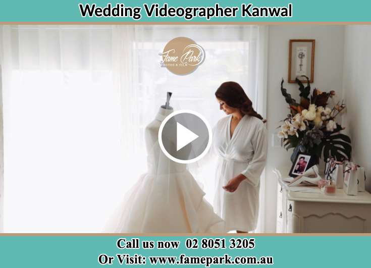 The Bride looking on her wedding gown Kanwal NSW 2259