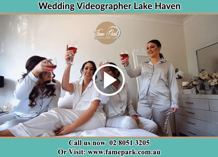 Bride and her secondary sponsors making toast during the pajama party Lake Haven NSW 2263