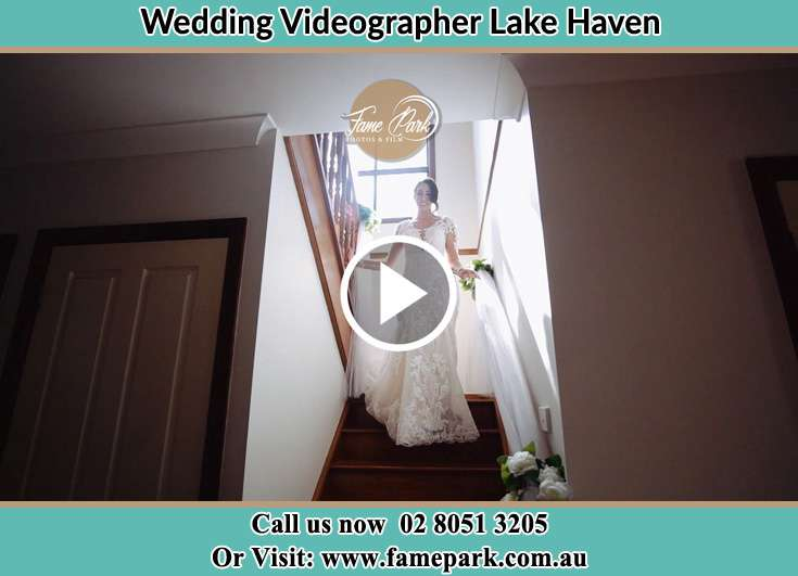 Bride walking down the staircase Lake Haven NSW 2263