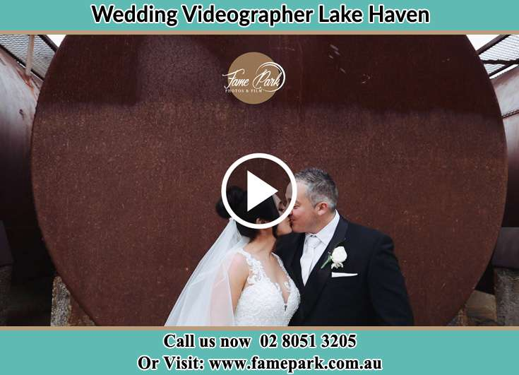 Bride and Groom kissed near the tank Lake Haven NSW 2263