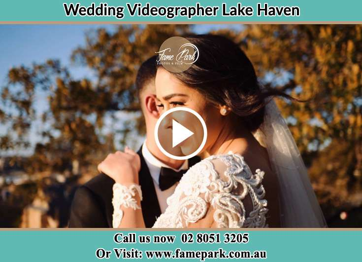 Bride and Groom hold each other Lake Haven NSW 2263