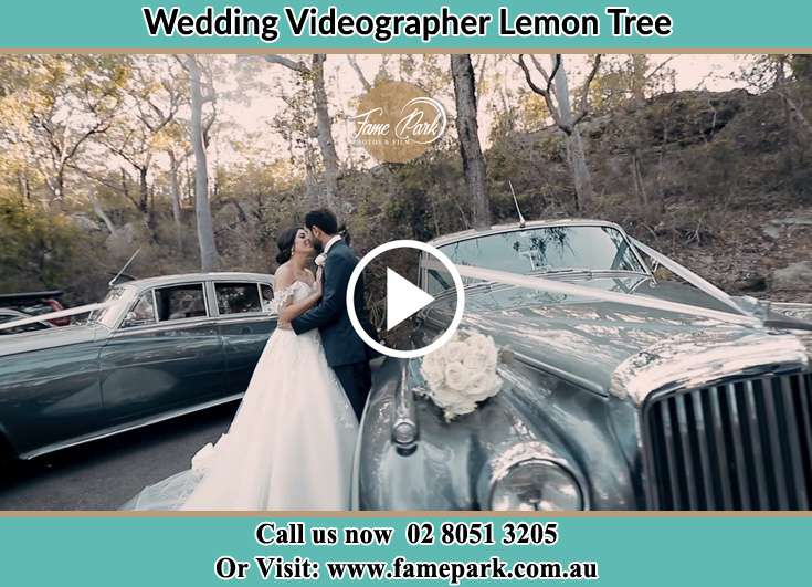 Bride and Groom kissed near the bridal car Lemon Tree NSW 2259