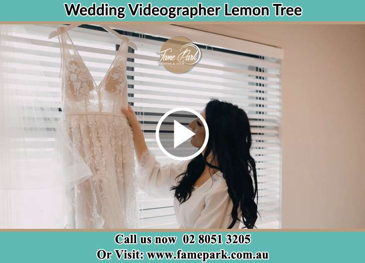 Bride looking at her dress Lemon Tree NSW 2259
