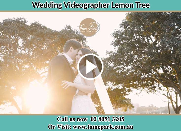 Bride and Groom hold each other at the park Lemon Tree NSW 2259