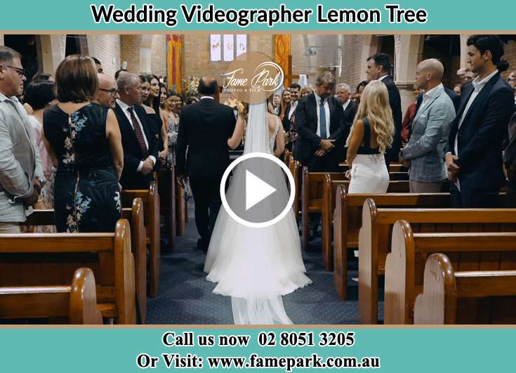 Bride and her father walking through the aisle Lemon Tree NSW 2259