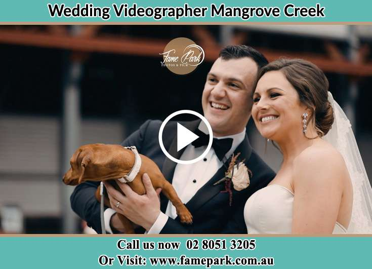 Bride and Groom with their dog at the bay other Mangrove Creek NSW 2250