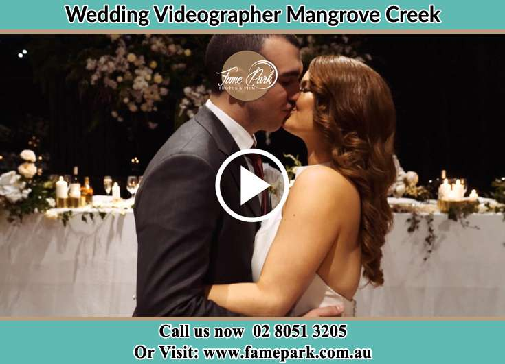 Bride and Groom kissed at the ceremony Mangrove Creek NSW 2250