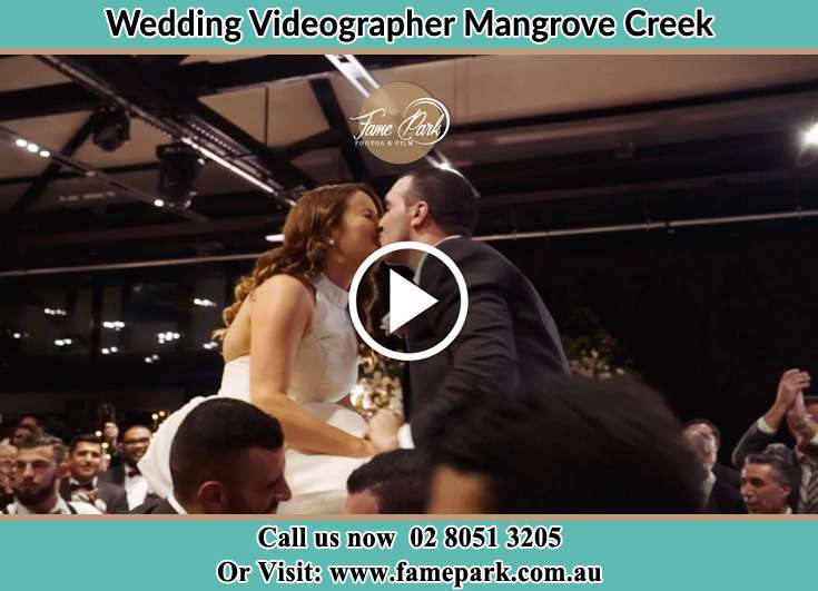 Bride and Groom kissed during the ceremony Mangrove Creek NSW 2250