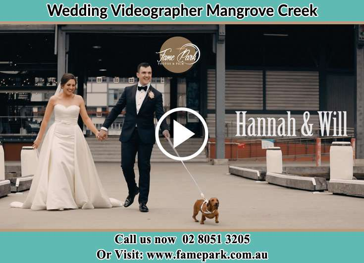 Bride and Groom walking with their dog Mangrove Creek NSW 2250