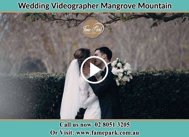 Bride and Groom kissed at the garden Mangrove Mountain NSW 2250