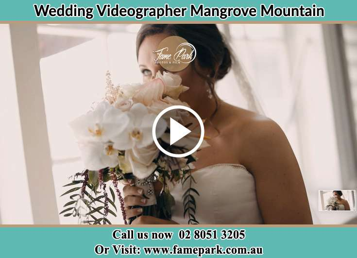 Bride smelling the bouquet of flowers Mangrove Mountain NSW 2250